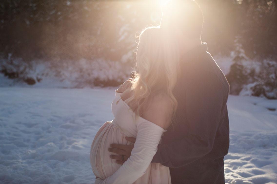 Maternity Photography, partner embraces pregnant woman