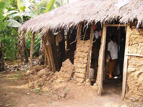 Before Tumaini helped this family, their house was falling down.