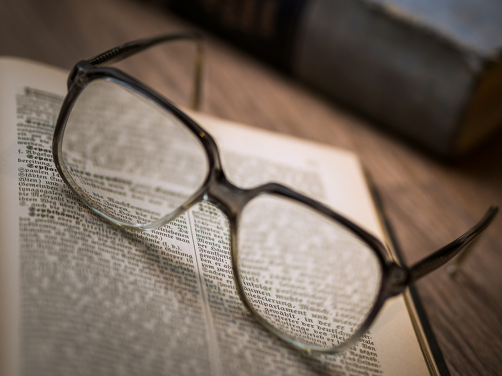 glasses on a book dictionary