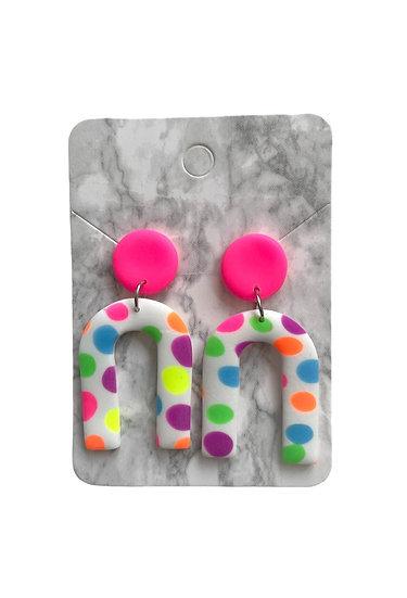 Spotty neon arch dangles