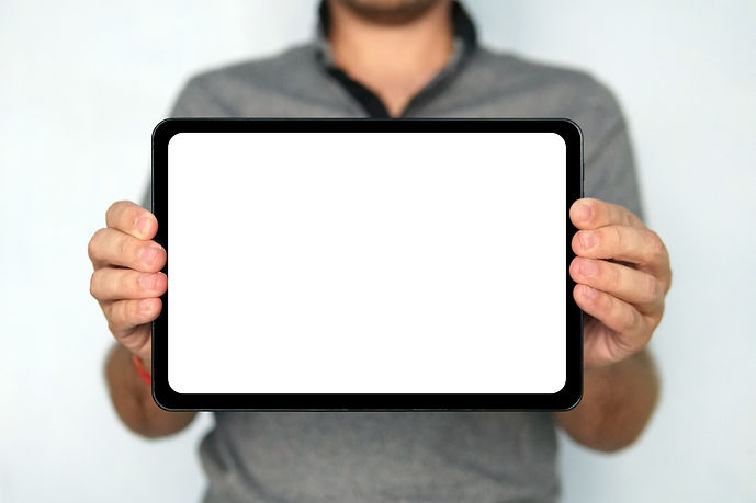 bigstock-Young-Man-Holds-A-Touch-Pad-Ta-