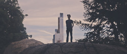 A man silhouetted against the skyline.