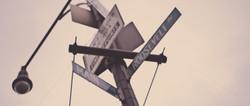 An upward facing angle of street signs.