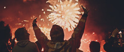 Silhouette of a man looking at fireworks.