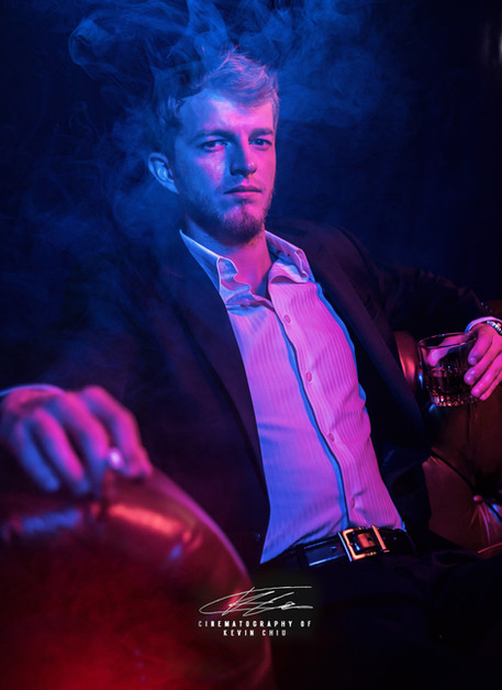 Man with cigarette with blue and purple lights