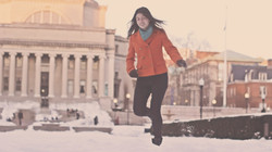 A woman running in the snow.