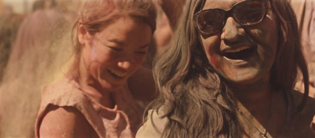 Two teen women having fun at a Holi festival.