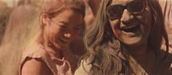 Two teen women having fun at a Holi festival.