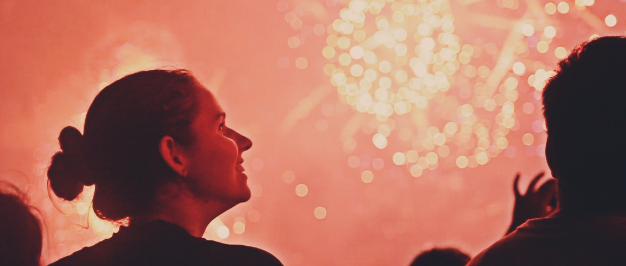 A woman looking at fireworks