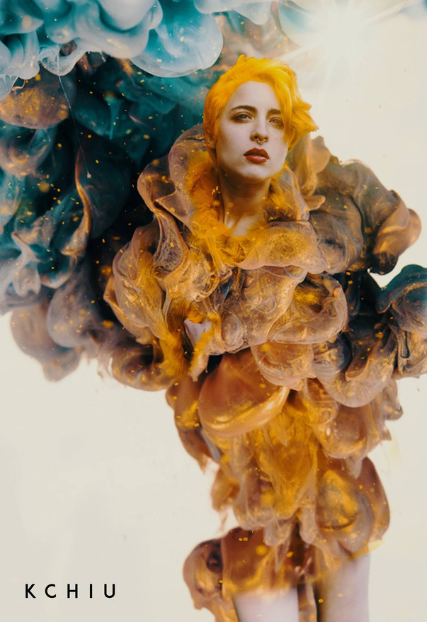 Artwork showing woman with yellow hair evaporating into gas