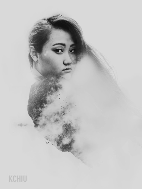 Double exposure of woman with clouds