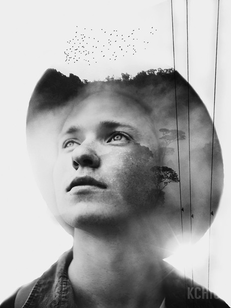 Double exposure portrait of a man and a forest with a power line