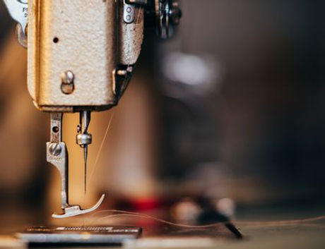 Sewingmachineneedle-GettyImages-524395021-591935f55f9b5864709c5d8c.jpg