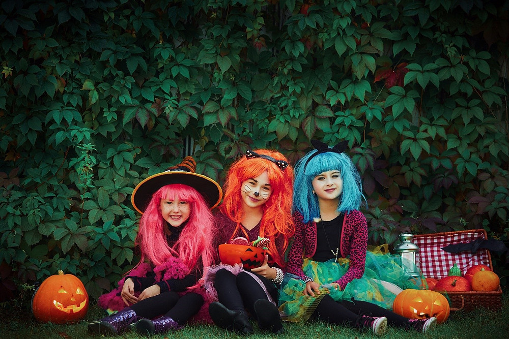 Little girls dressed in Halloween costumes