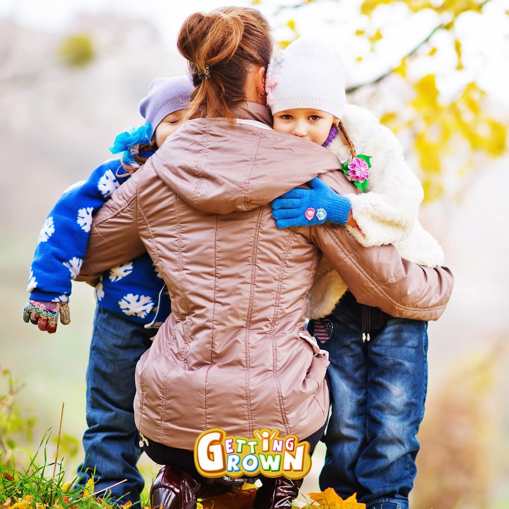 Mother hugging two children