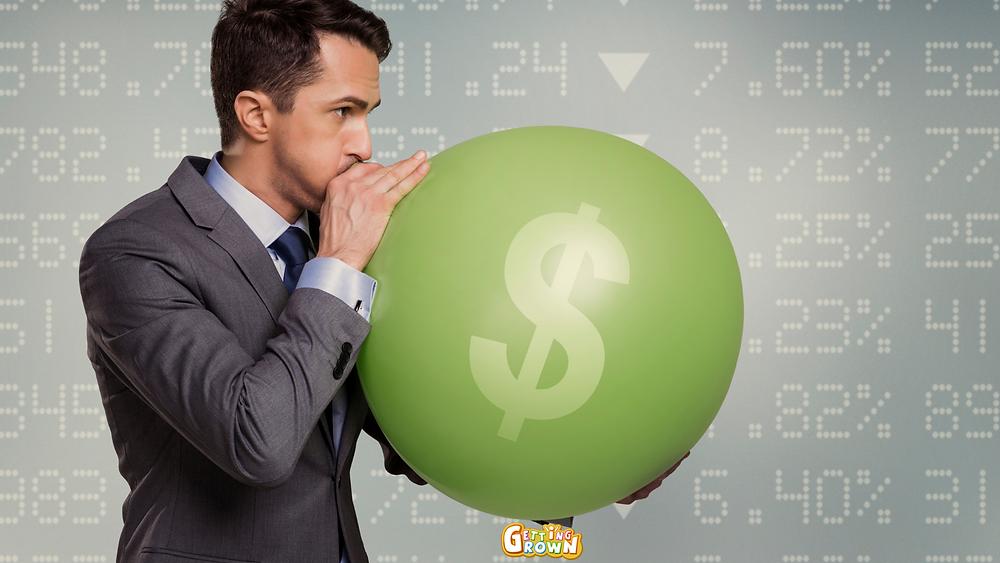 A man blowing up a money balloon