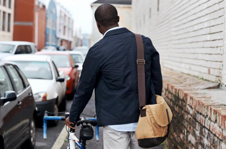 Man walking bike