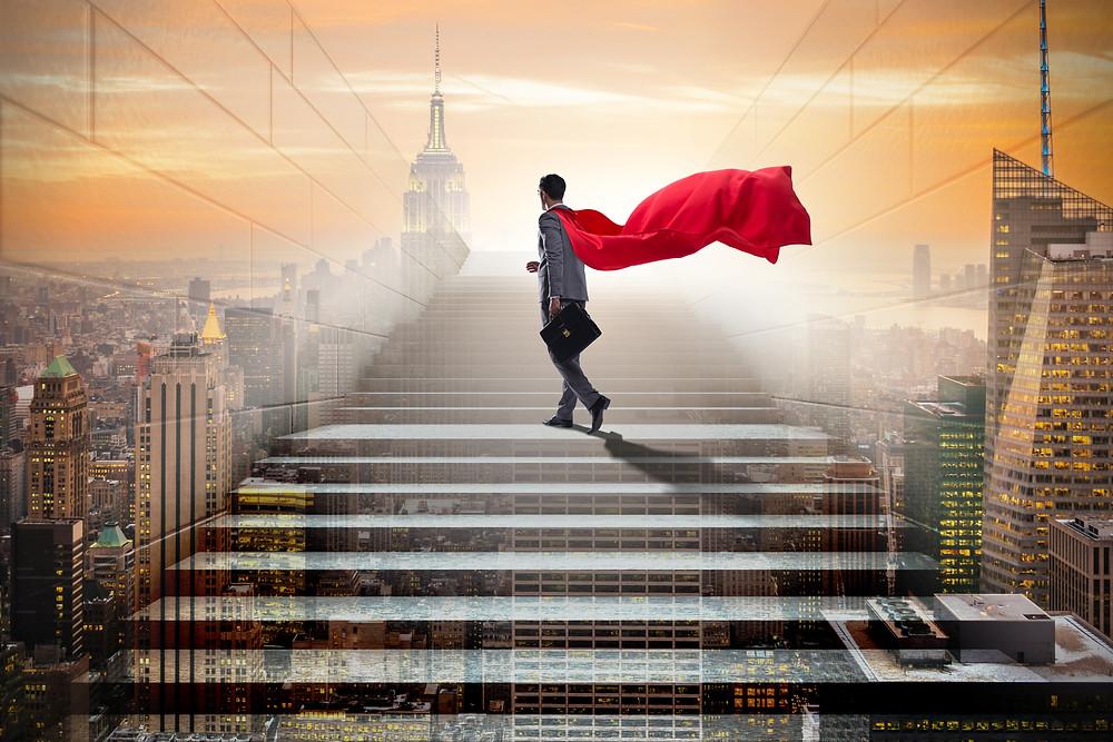 Businessman Superhero waking on steps into the sky