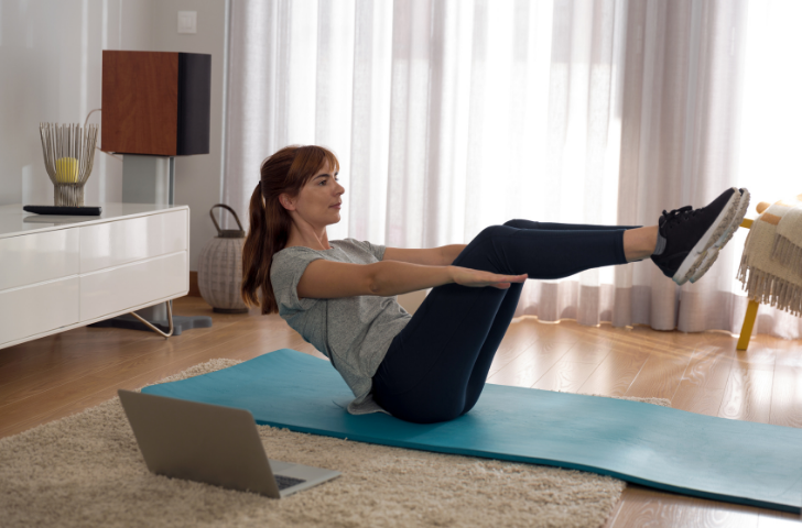 A woman holding a V core position