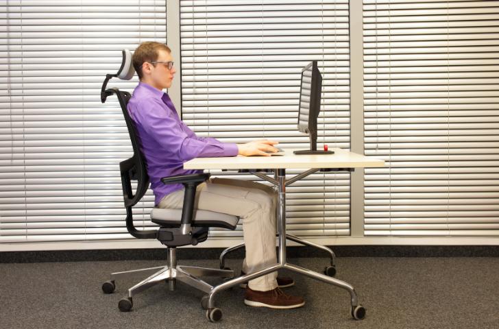 A man sitting in an ergonomic chair