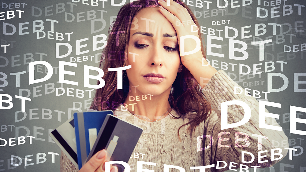A woman stressed about debt