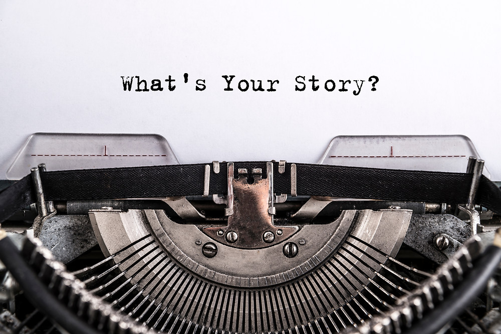 Old typewriter displaying What's Your Story