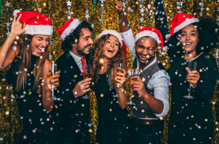 Team of people cheering at a Holiday party