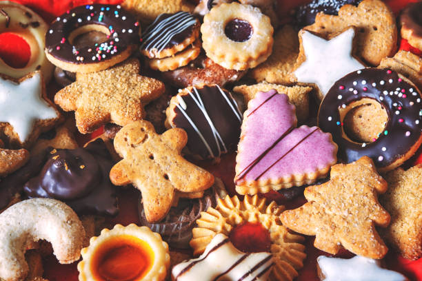 Assortment of decorated holiday cookies sitting on a table