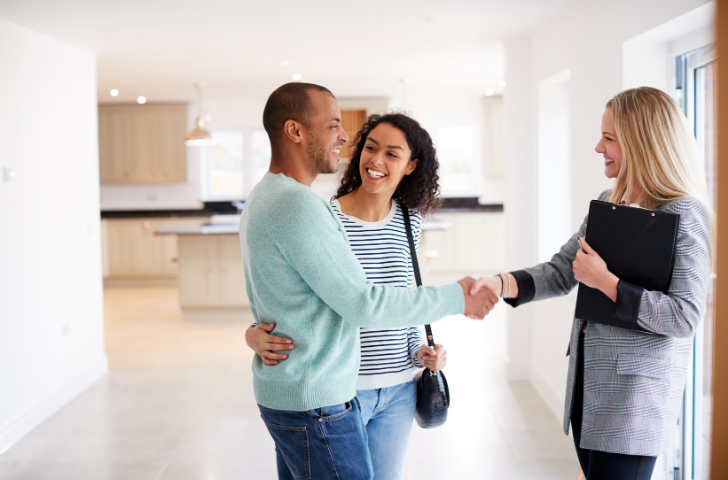 Couple touring a house with a realtor