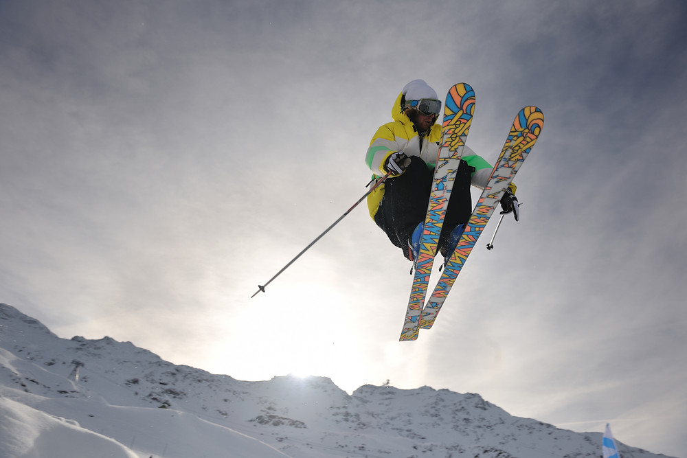 Man jumping in the air on skis