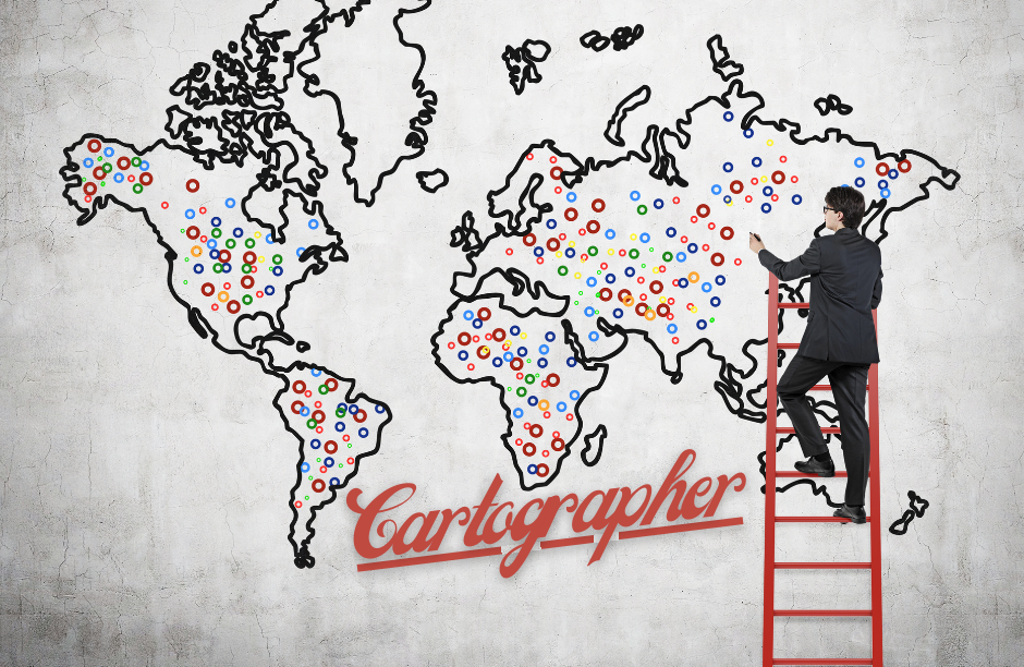 Man standing on ladder to draw on wall map of earth