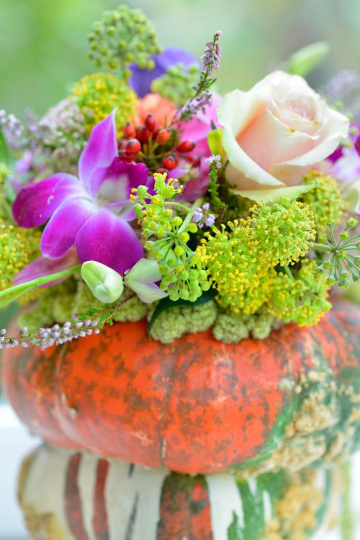 pumpkin vase with pretty flowers