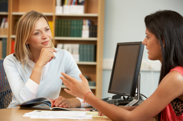 Two woman talking at the office