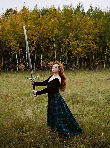 red haired woman with a sword