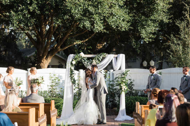 First Kiss under the arch in the Wedding Garden