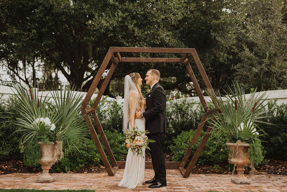 Bride and Groom under the Hexagon Arch -