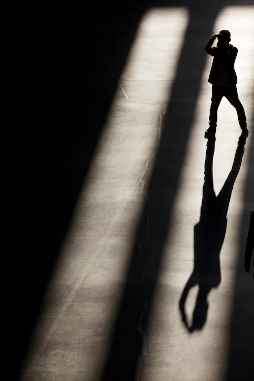 Silhouetted man with camera