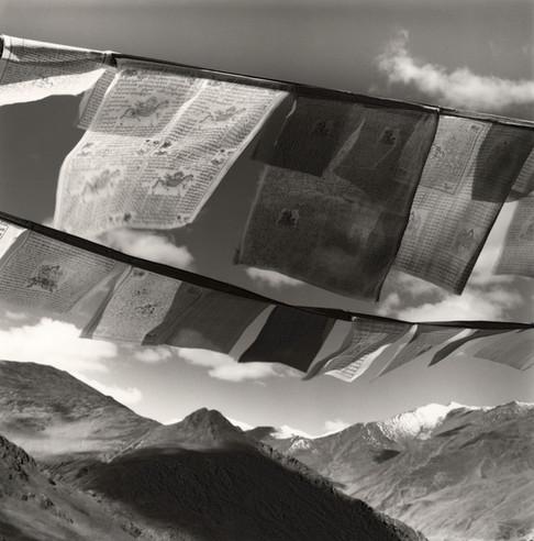 Prayer flags & Mountain Range in Tibet