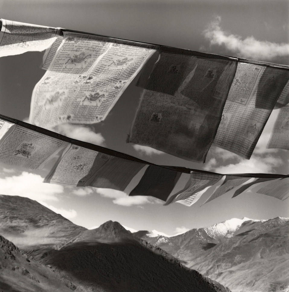 Prayer flags & Mountain Range in Tibet