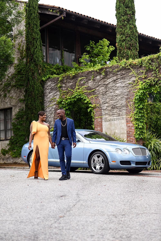 black couple holding hands in front of Summerour Studio in Atlanta