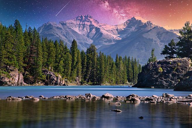 Colorful night sky shining over Banff mo