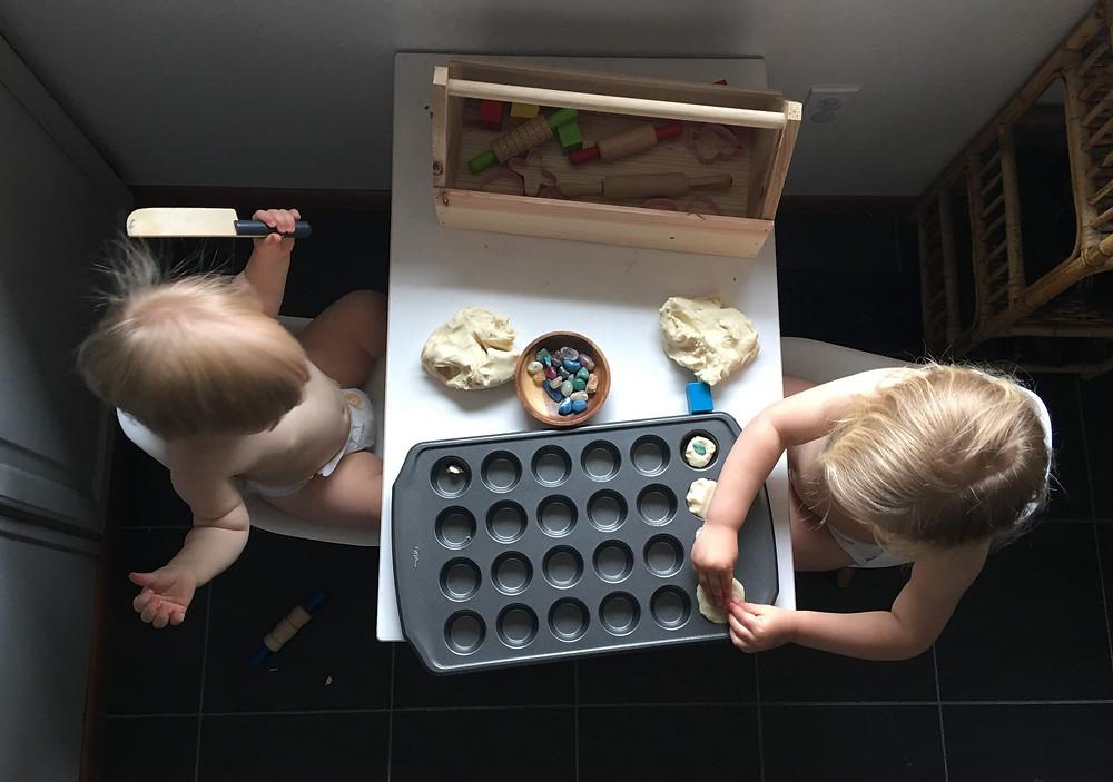 arial shot of children making playdough muffins