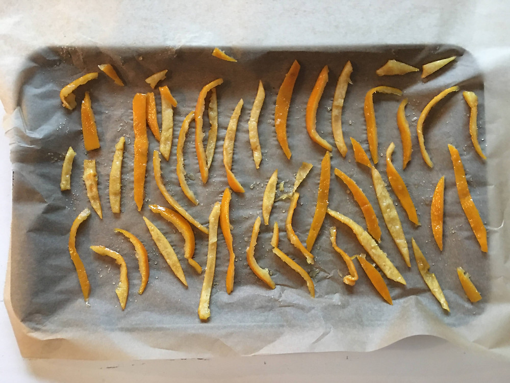 candied orange peel slices laying out to dry