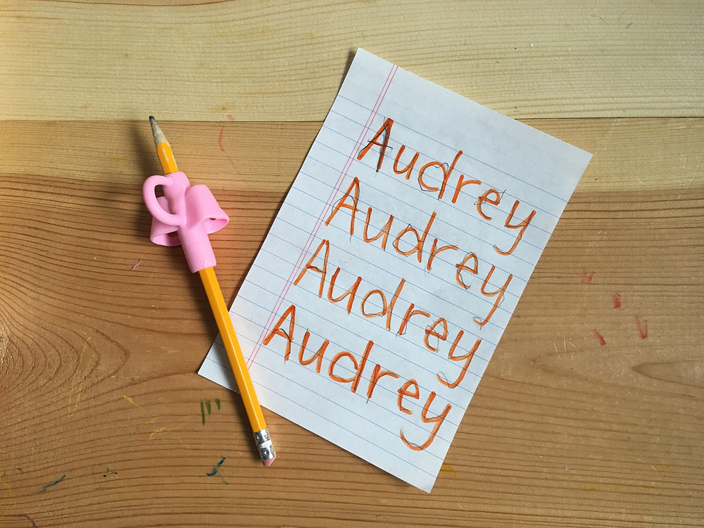 """Child's name writing practice """"Audrey"""" pencil with pink grip guide"""