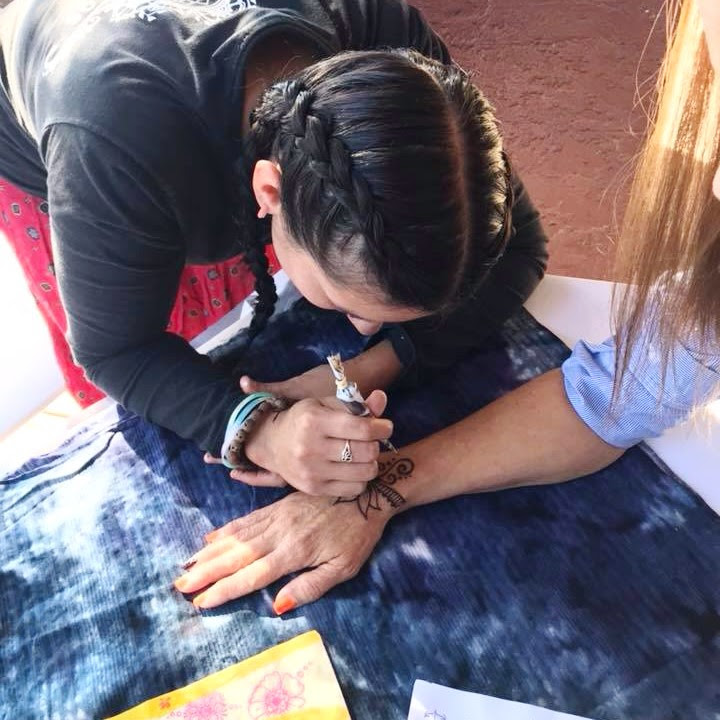 Sally doing her aristic Henna.