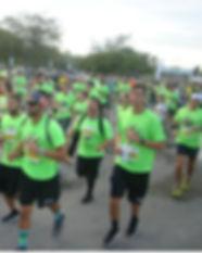 Many people running the race Zoo Run 5k.