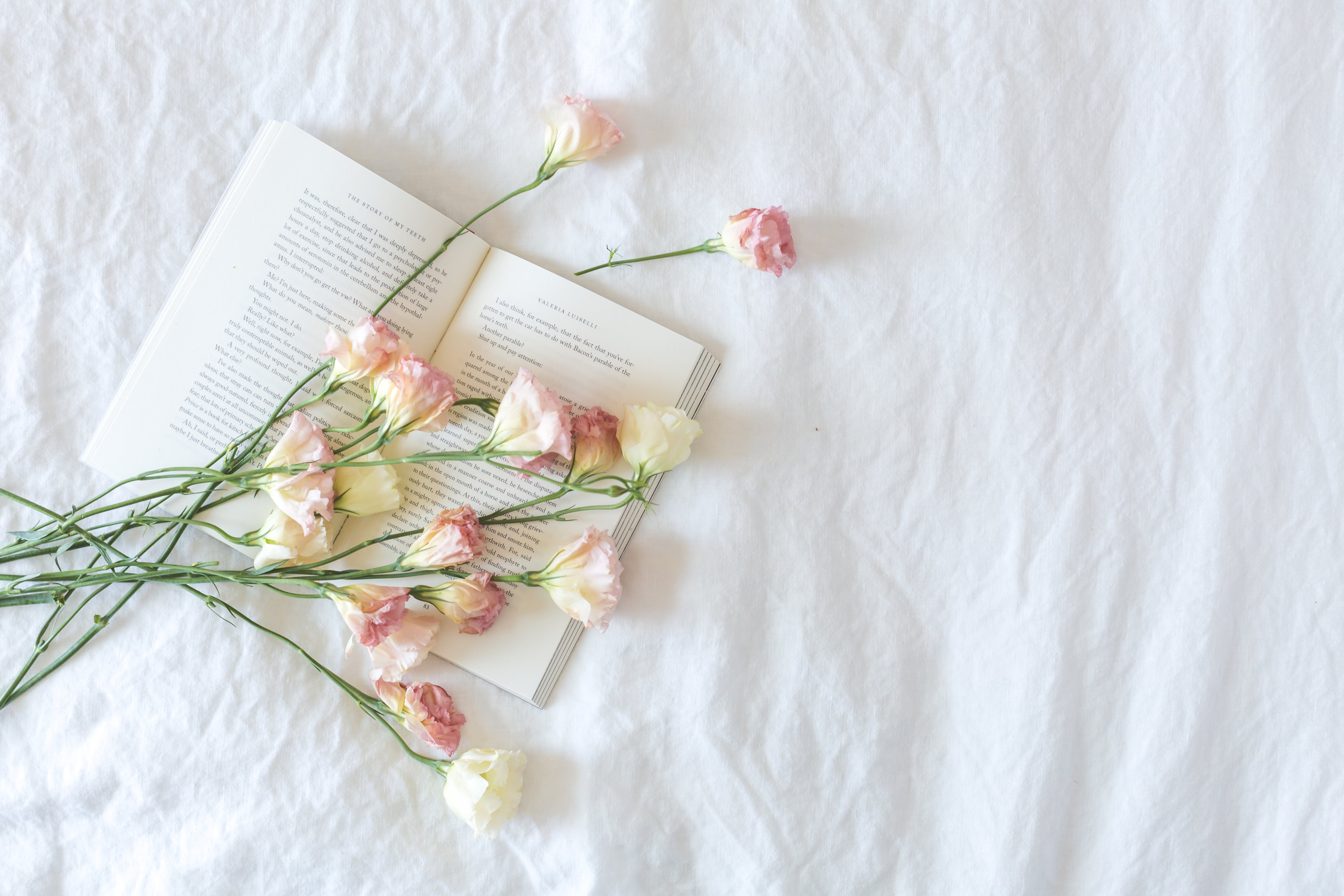 bed-with-book-and-flowers
