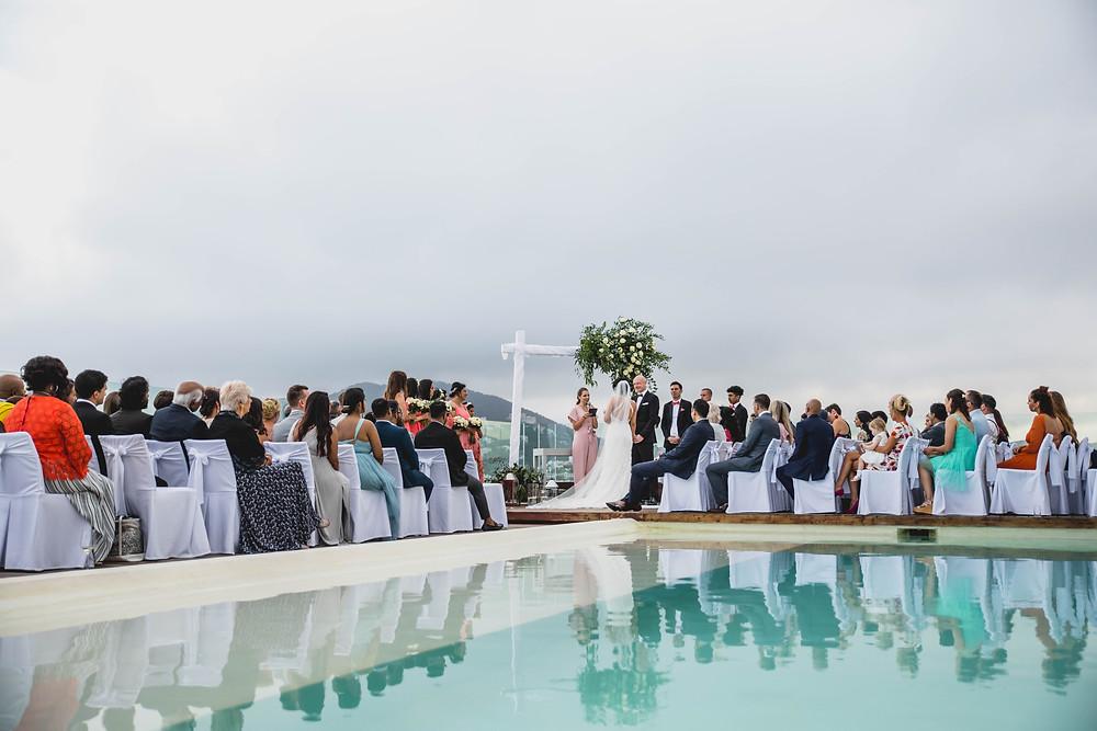 Aguas de ibiza roof terrace wedding ceremony held in front of swimming pool. ibiza wedding