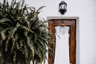 boho wedding dress hanging from door frame of can gall hotel