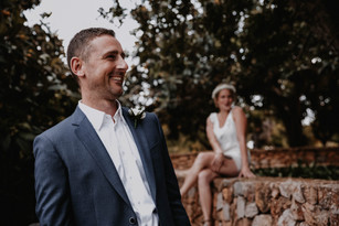 groom laughing while getting ready on his wedding day
